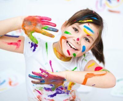 Girl with messy painted hands